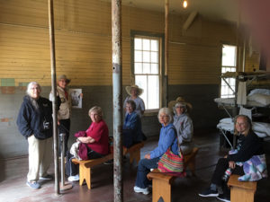 Marshall Grimes, docent at Angel Island, guided CPC members through the museum at the Immigration Station. The facility served as a detention center for nearly 500,000 immigrants from 1910 through 1940.
